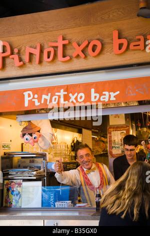 SPAIN Barcelona Juan Pinotxo owner of bar in La Boqueria produce market give thumbs up - Stock Photo