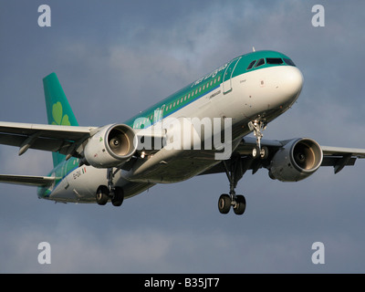Aer Lingus Airbus A320 twin-engine commercial passenger jet plane on approach. Closeup front view. - Stock Photo