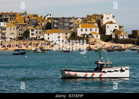 St Ives Harbour with boats and  seaside houses in Cornwall, England. - Stock Photo