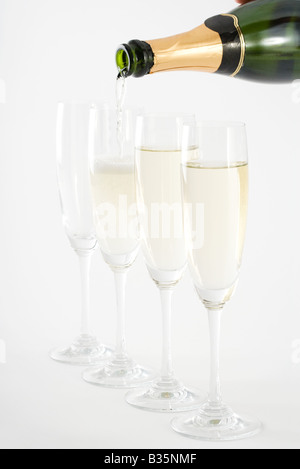 Pouring champagne into glasses, close-up - Stock Photo