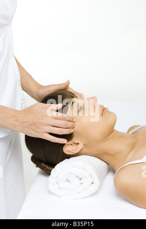 Woman receiving head massage, cropped view - Stock Photo