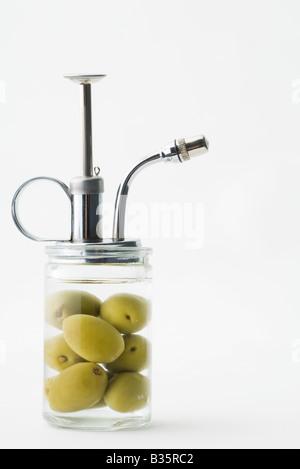 Spray bottle with olives inside - Stock Photo