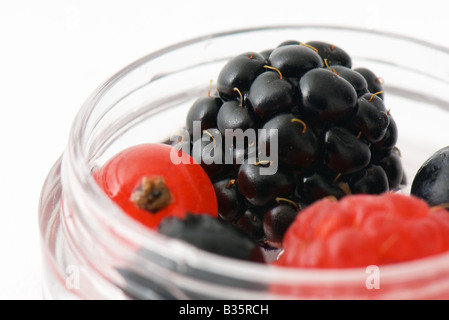 Berries in small cosmetic container, close-up, cropped - Stock Photo