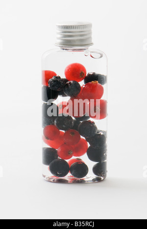 Fresh berries in cosmetic bottle - Stock Photo