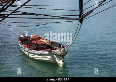 A dingy boat tied up to the US Brig Niagara dock in Port Washington Wisconsin - Stock Photo