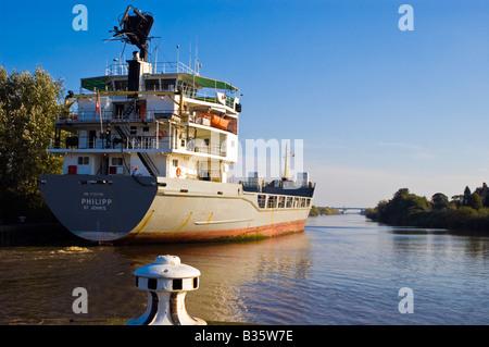 Ship passing through Latchford locks at Warrington on Manchester ship canal heading to Salford docks, UK - Stock Photo