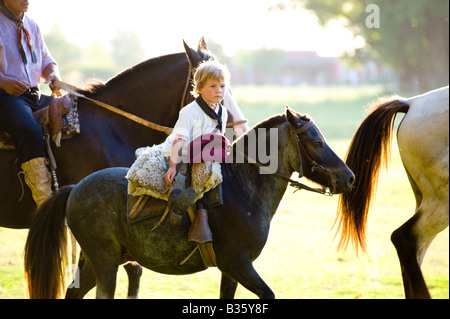 Young Gaucho on Horseback, Buenos Aires, Argentina - Stock Photo