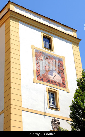 Old sun dial on a wall of a historic building in Passau - Stock Photo