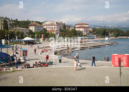 Opatija Istria Croatia Europe May The concrete sea front promenade is hugely popular with holiday makers - Stock Photo