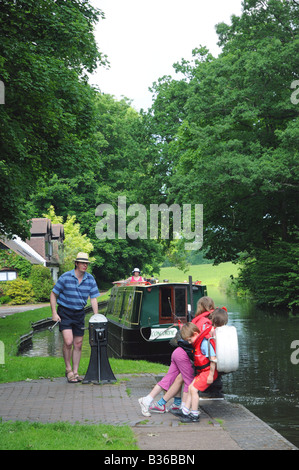 Family on a canal holiday passing through Hyde Lock on the Staffordshire and Worcestershire Canal Kinver S Staffordshire - Stock Photo