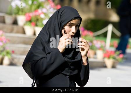 Teenage Iranian Girl Lowering her Sunglasses at the Tomb of Hafez in Shiraz Iran - Stock Photo