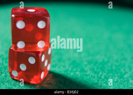 Dice sitting on a poker table (close up/selective focus) - Stock Photo