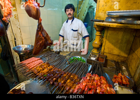 Vendor Selling Raw Skewered Lamb in the Souk in the Old City in Aleppo Syria - Stock Photo