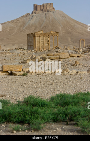 Ancient Roman Funerary Temple and Arab Castle Qalaat Ibn Maan in Palmyra Syria - Stock Photo