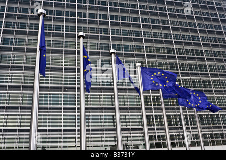 European flags flying in front of the Berlaymont in Brussels, Belgium. - Stock Photo
