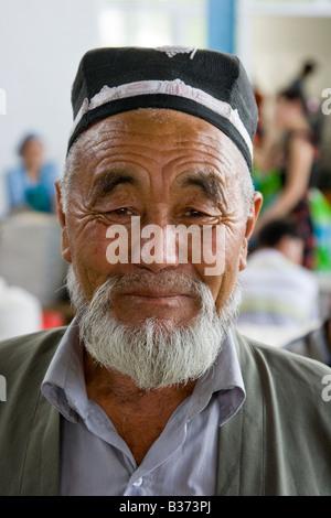 Uzbek Man Wearing a Traditional Hat in the Siab Bazaar in Samarkand Uzbekistan - Stock Photo