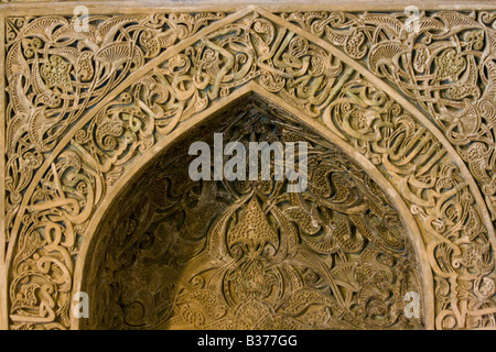 Ornate Arabic Calligraphy on the Oljeitu Mihrab at the Jameh Masjid in Esfahan Iran - Stock Photo