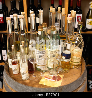 different typs of liquor decorated on a barrel - Stock Photo