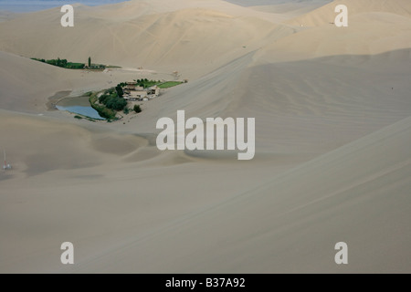 Crecent Moon Lake at Singing Sands Mountain Sand Dunes in Dunhuang China - Stock Photo
