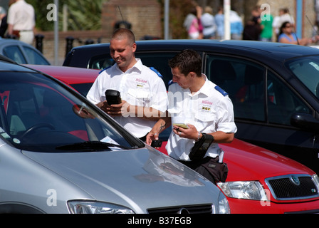 Civil parking enforcement officer issue a penalty ticket Worthing on Sea West Sussex England UK NCP Services contract - Stock Photo