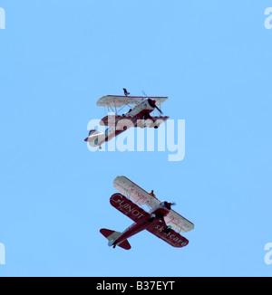 Team Guinot air display Boeing Stearman biplane aicraft in formation advertising the skincare product - Stock Photo