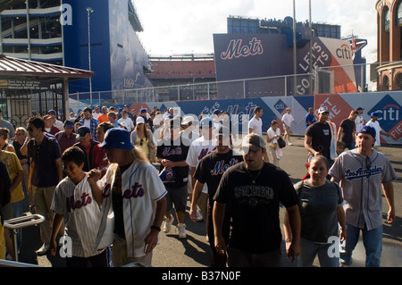 Crowds leave Shea Stadium in Flushing Queens in NYC at the end of a New York Mets game - Stock Photo