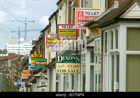 For sale and to let signs on houses in Selly Oak Birmingham. - Stock Photo