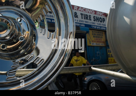 Automobile repair related businesses take up the bulk of the industry in Willets Point in the New York borough of - Stock Photo