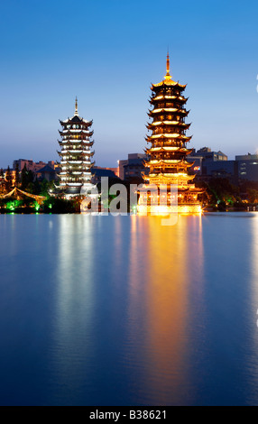 Double Tower of the sun and moon Shanhu Lake Guilin Southern China - Stock Photo