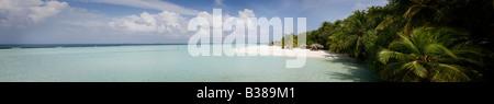 Panoramic view of desert island beach in South Ari Atoll in Maldives near India - Stock Photo