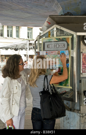 Two female tourist in downtown at Stureplan consults a map over central Stockholm Sweden - Stock Photo