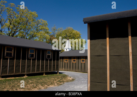 A reconstruction of a World War II training camp includes the typical tarpaper barracks used in that era. - Stock Photo