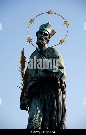 Aug 2008 - Statue of St John Nepomuk on Charles Bridge Prague Czech Republic - Stock Photo