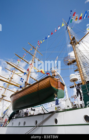 Wooden lifeboat on Cuauhtemoc three masted Barque from Mexico in Tall Ships race berthed in dock Britain UK - Stock Photo