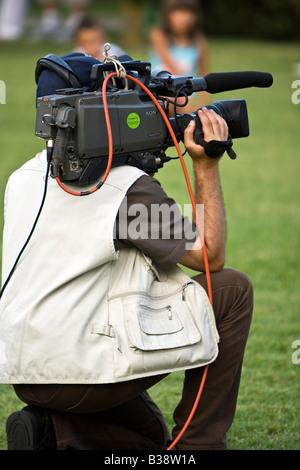 Professional TV news cameraman. - Stock Photo