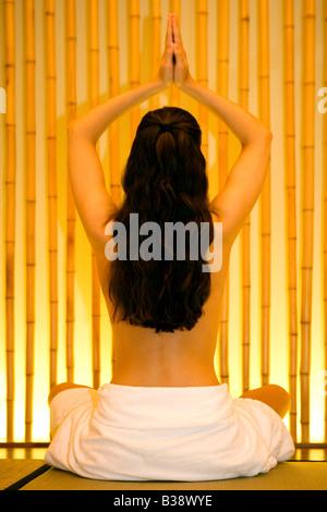 Frau bei einer Yoga Uebung, woman doing yoga exercise - Stock Photo