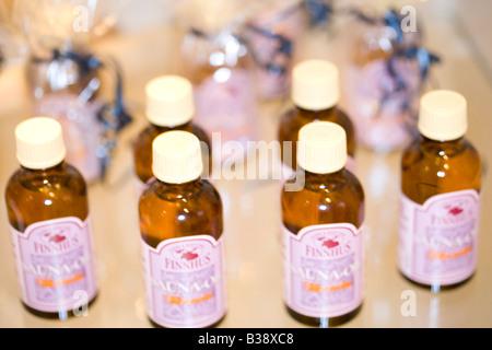 kleine Flaeschchen mit Saunaoel, small bottles with sauna oil - Stock Photo