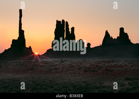 First light at Yei bi Chai rocks in Monument Valley - Stock Photo