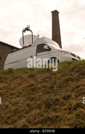An uplink satellite dish mounted on roof of a vehicle used for fast response news coverage - Stock Photo