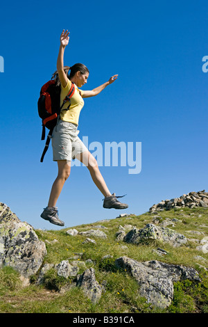 Junge Frau beim Wandern in den Bergen, young woman walking in the mountains - Stock Photo
