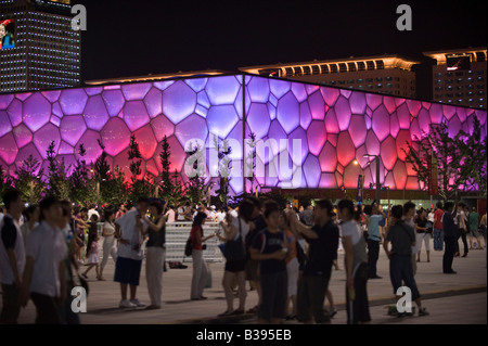 People gather in front of the Beijing National Aquatics Center, also know as Water Cube, during the Beijing 2008 - Stock Photo