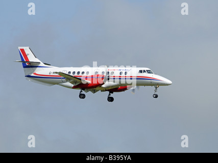 An Eastern Airways BAe Jetstream 4102 on final approach to Aberdeen Dyce Airfield Grampian Region North East Scotland - Stock Photo