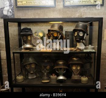 German World War Two helmets and gas masks, bunker, Berlin - Stock Photo