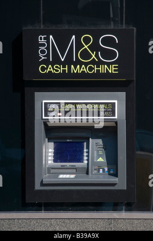 Marks and spencer money ATM cash machine on exterior wall of store - Stock Photo