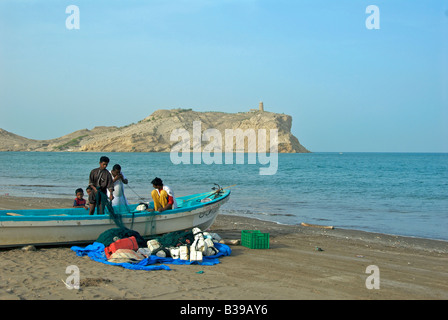 Fishersmen preparing nets Sawadi Beach Al Batinah Region Sultanate of Oman - Stock Photo