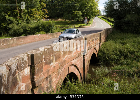 UK Cheshire Aldford car crossing bridge over River Dee at ford on Watling Street Roman Road - Stock Photo