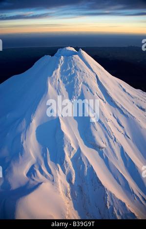 First Light on Summit of Mt Taranaki Mt Egmont Taranaki North Island New Zealand aerial - Stock Photo
