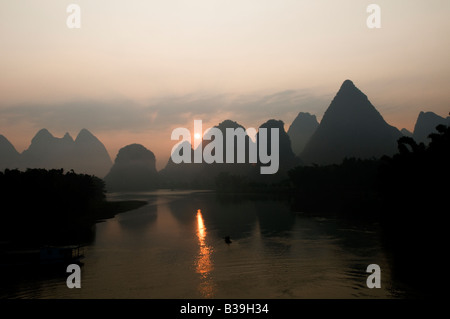 Dramatic sunrise over the beautiful mountains around the Li River near Guiling, China - Stock Photo
