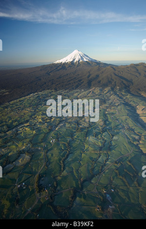 Frosty Farmland and Early Light on Mt Taranaki Mt Egmont Egmont National Park Taranaki North Island New Zealand - Stock Photo