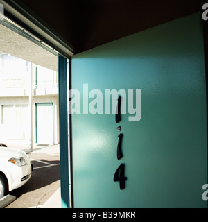 Motel room door on first floor that has been left open - Stock Photo